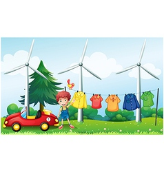 A boy in the garden with his car and hanging vector