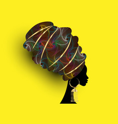 Beautiful african woman in traditional wax turban vector