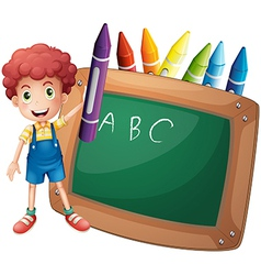 A little boy holding a big violet crayon near the vector image vector image