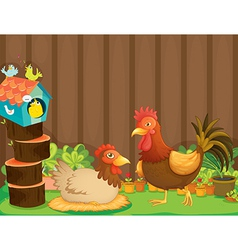 A hen and a rooster beside the bird house vector
