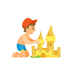 Boy in swim trunks and cap building sand castle vector