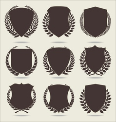 Shield and laurel wreath vector image