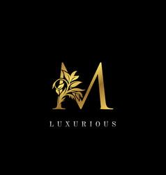 Classy golden m letter floral logo vintage drawn vector