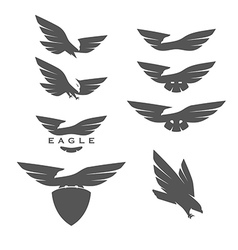 Set negative space emblems with eagles vector