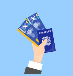 hand holding passport and tickets isolated on blue vector image