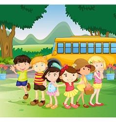 Children standing by the schoolbus vector image vector image