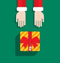 Santa Claus hand give gift Merry Christmas vector image