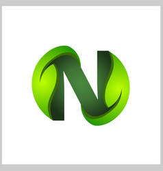 n letter with green leaves logo vector image