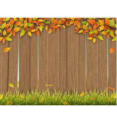 old wooden fence autumn tree and grass vector image