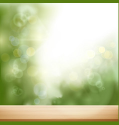 wooden table on blurred natural background vector image