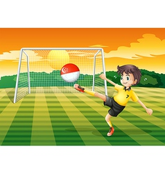 A female soccer player kicking the ball vector
