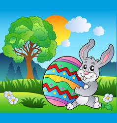 Meadow with tree and easter bunny vector