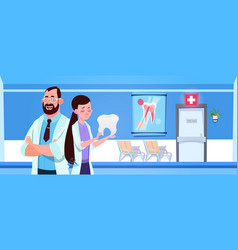 man and woman doctors team holding tooth over vector image