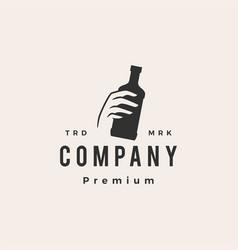 hand hold bottle hipster vintage logo icon vector image