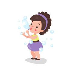 sweet cartoon brunette little girl blowing and vector image vector image