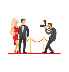 Paparazzi taking shot of celebrities on red carpet vector