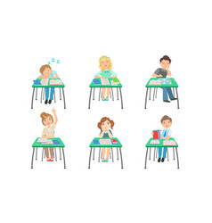 cute primary schools pupils sitting at desks at vector image