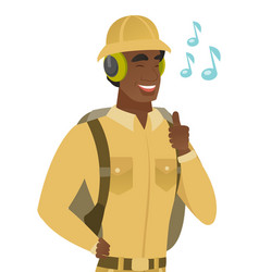 African traveler listening to music in headphones vector