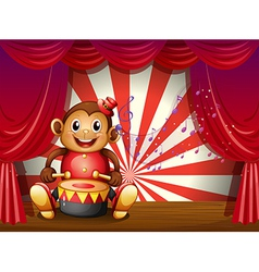 A monkey playing with a musical instrument at the vector image