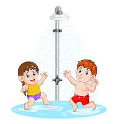 children are playing under shower vector image