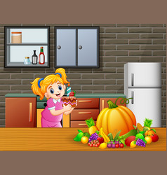 cute cartoon a girl holding a cake in the kitchen vector image