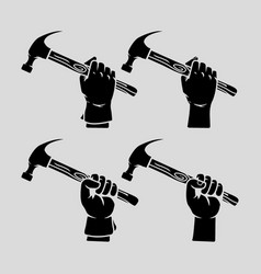 hand holding hammer silhouette vector image