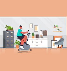 Man riding stationary bike at home guy having vector