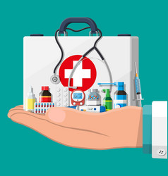 medical first aid kit with different pills devices vector image