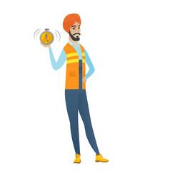 Young hindu builder holding alarm clock vector