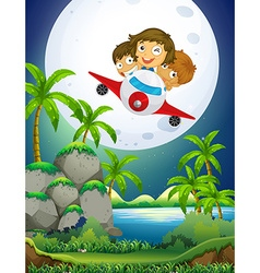 Children riding airplane over the park vector image