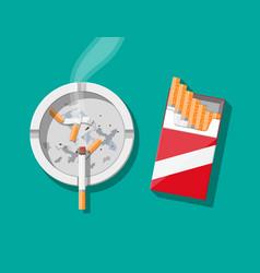 White ceramic ashtray full of smokes cigarettes vector