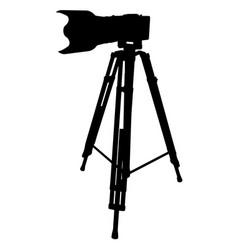 Black camera and tripod on a white vector