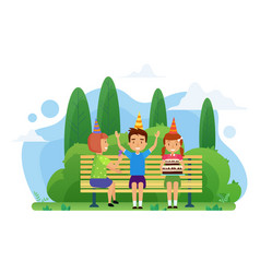 kids celebrate birthday on a bench in park vector image