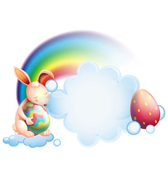 A bunny holding an egg while sleeping in front of vector image