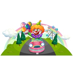 A happy clown riding in a pink car vector image vector image