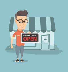 Caucasian shop owner holding open signboard vector