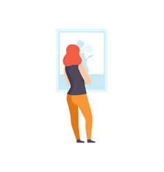 Woman in casual clothing looking at the painting vector