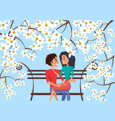 couple sit on bench surrounded with cherry blossom vector image