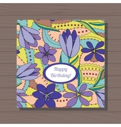 Happy birthday card with crocuses on wooden vector image vector image