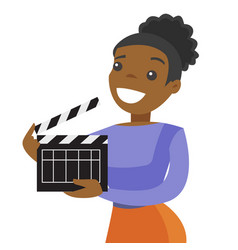 Young african woman holding a movie clapper board vector