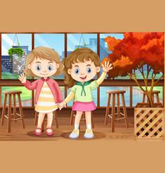 Two happy girls in restaurant vector