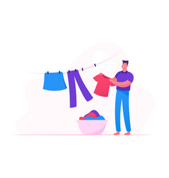 Young man hanging clean wet clothes on rope taking vector