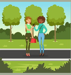 two girlfriends talking while walking in the park vector image