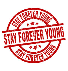 Stay forever young round red grunge stamp vector