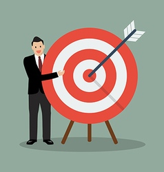 Businessman pointing to the big target vector image vector image