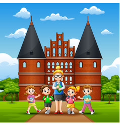 happy kids study tour in holstentor vector image