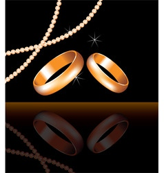 vector golden wedding rings and pearl beads vector image