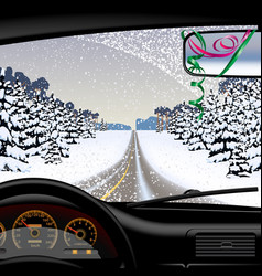 Winter road in snowfall from inside of the car vector