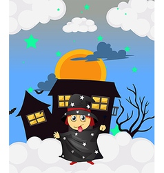 A witch near a haunted house vector