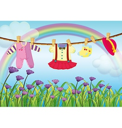 Hanging baby clothes near the garden with fresh vector